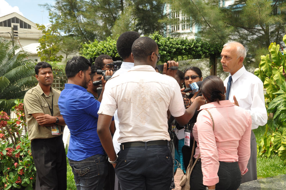 Minister Bulkan talks with the media during the opening of Parliament Square
