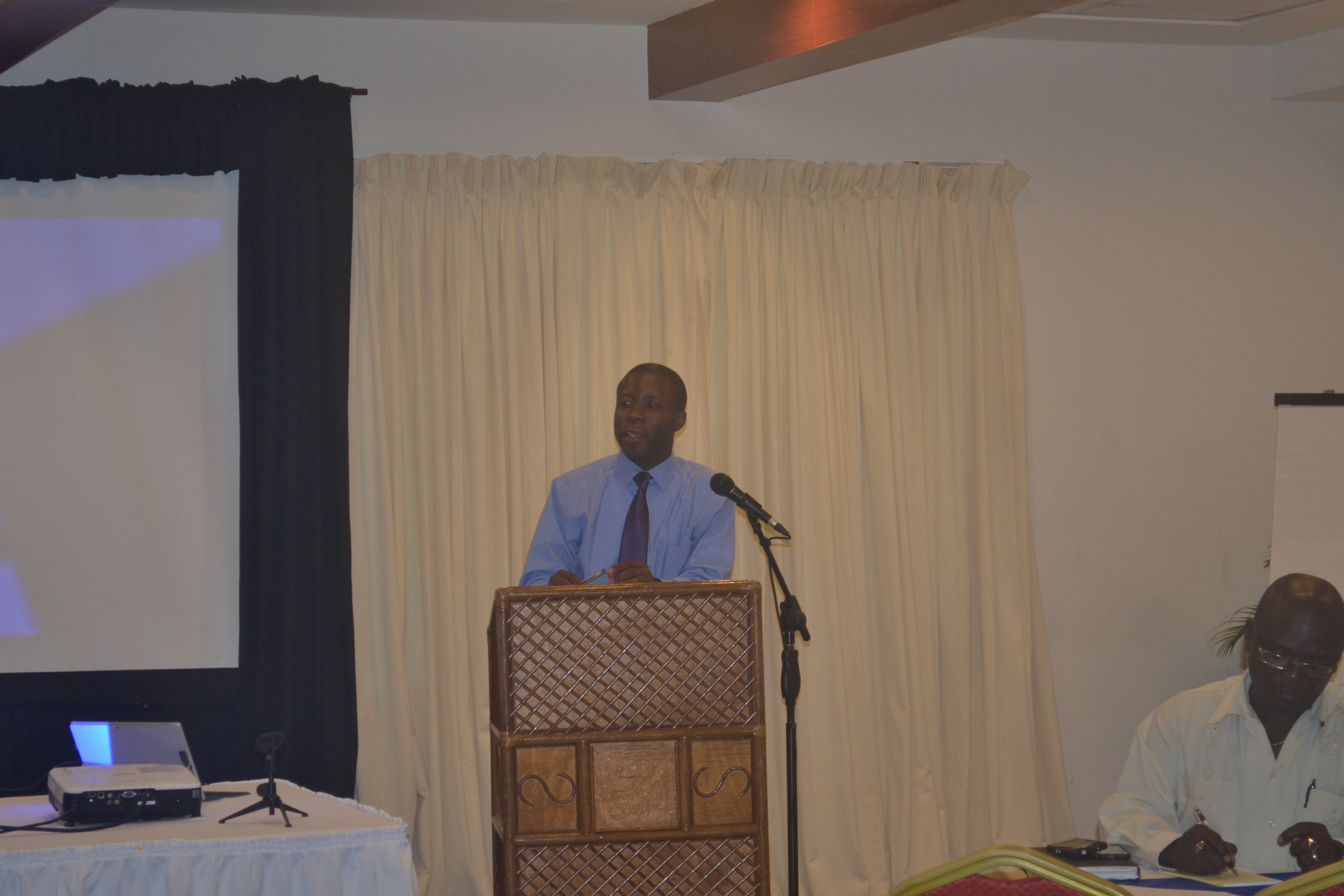 CDB Portfolio Manager of the Economic Infrastructural Division (EID) William Ashby entertains discussion on the durability of the roads constructed under the CRIP project