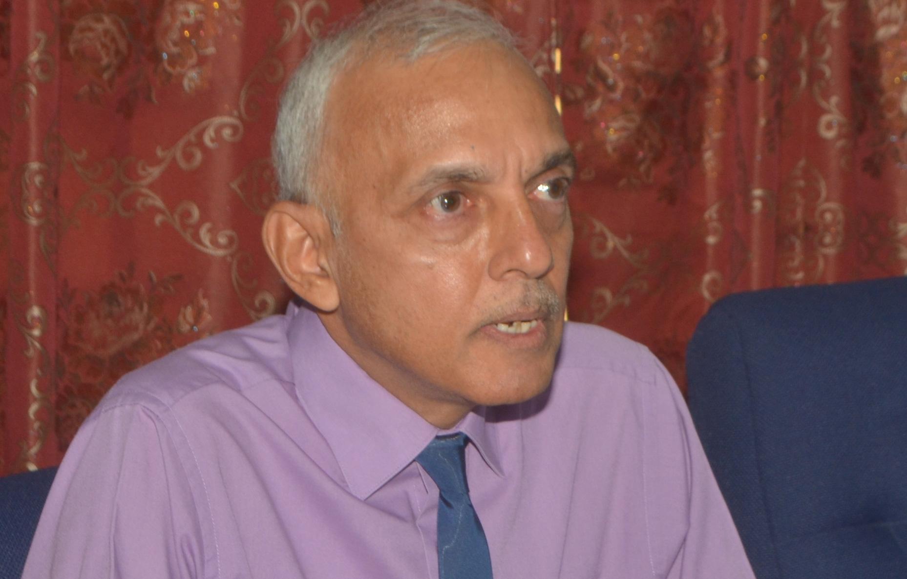Communities Minister Ronald Bulkan addressing the press at his Kingston office