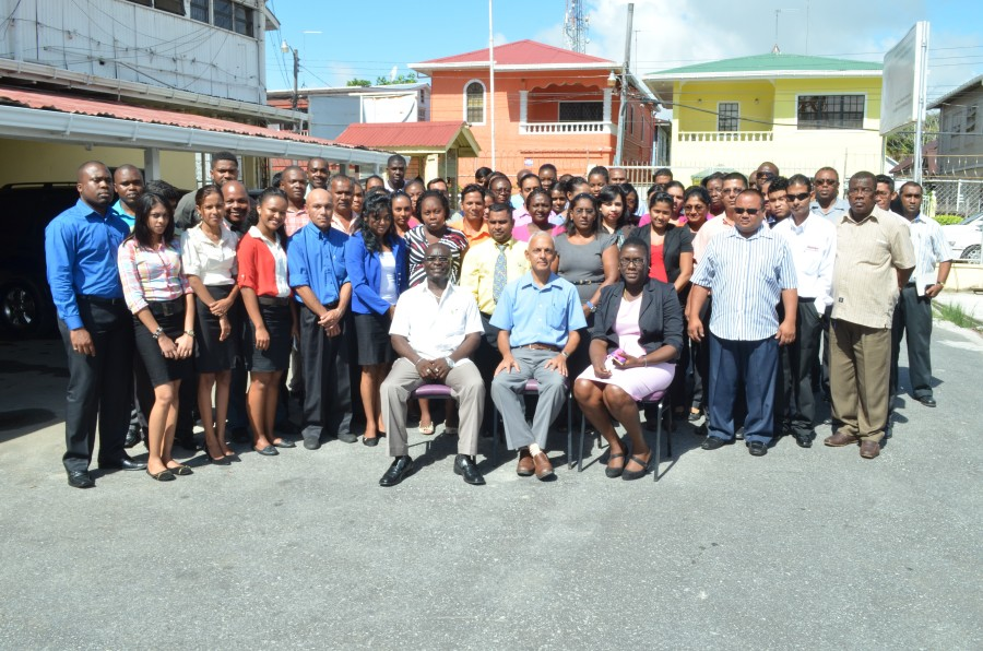 Minister of Communities Ronald Bulkan (C), Permanent Secretary Emil Mc Garrell, DPS Abeena Moore and staff of the Departments for Local Government and Regional Development
