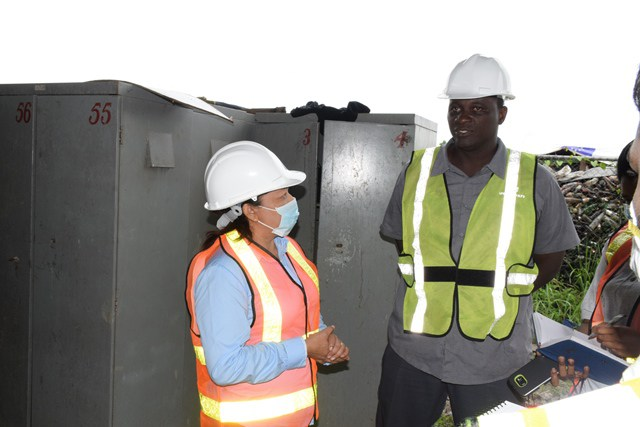 Minister within the Ministry of Communities, Dawn Hastings-Williams being briefed by Haags Bosch Sanitary Landfil Site Manager, Lloyd Stanton during the tour of the site, located behind of Eccles, East Bank Demerara.