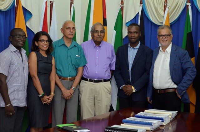(left to right) Minister of Communities Ronald Bulkan, Permanent Secretary (PS), Ministry of Communities, Emile Mc Garrel, Mayor of Bartica Gifford Marshall with the contractors.