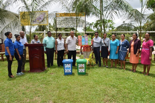 Town Council Members and Primary school teachers in Region one, Mabaruma accepting waste receptacles and posters from the Ministry of Communities team.