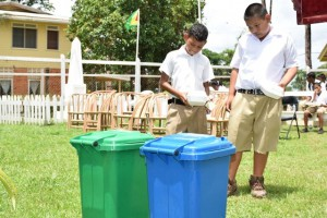 Students practicing waste disposal after a snack.