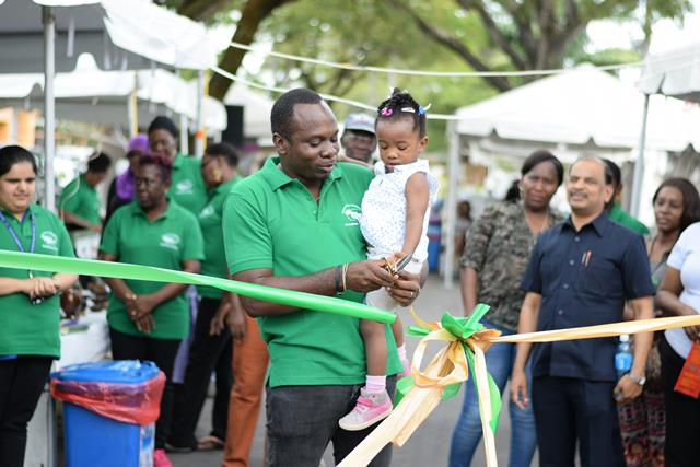 Darren Shako, Consultant Ministry of Communities cutting the ribbon opening of the exhibitors.