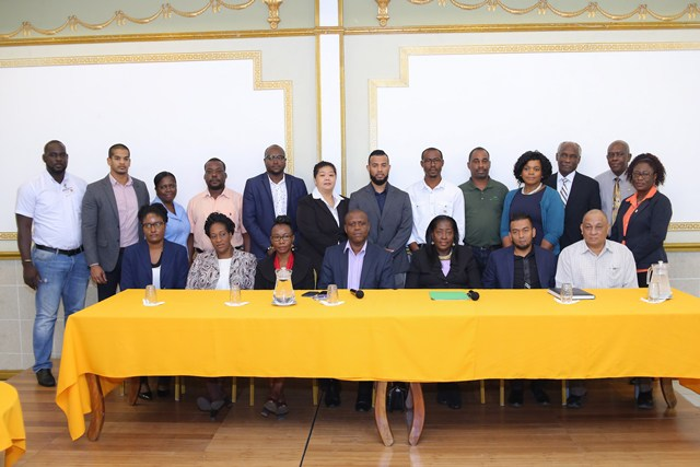 Minister within the Ministry of Communities, Valarie Adams-Yearwood, and CHPA CEO, Lelon Saul (seated, centre) with the seven shortlisted housing developers and other CHPA staff