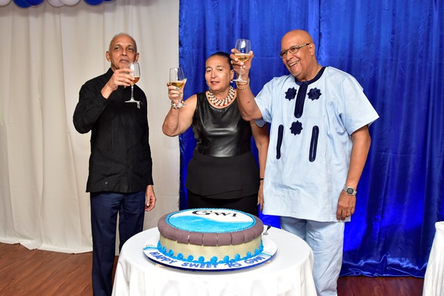 (Minister of Communities, Ronald Bulkan, Chairperson of GWI's Board of Directors, Patricia Chase-Green and Managing Director, Dr. Richard Van West Charles celebrate 16 years.