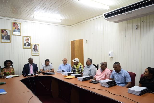 (From Left) Chief Executive Officer, Lelon Saul, Director of Projects, Omar Narine and several contractors at the signing for infrastructure developments in Providence and Peter's Hall