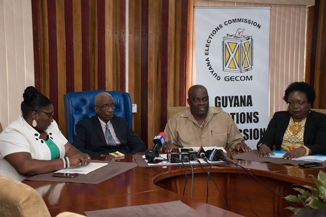 Chief Elections Officer of GECOM, Keith Lowenfield is flanked by Chairman (retd) Justice James Patterson, Public Relations Officer Yolanda Ward and Deputy Chief Elections Officer, Roxanne Myers.