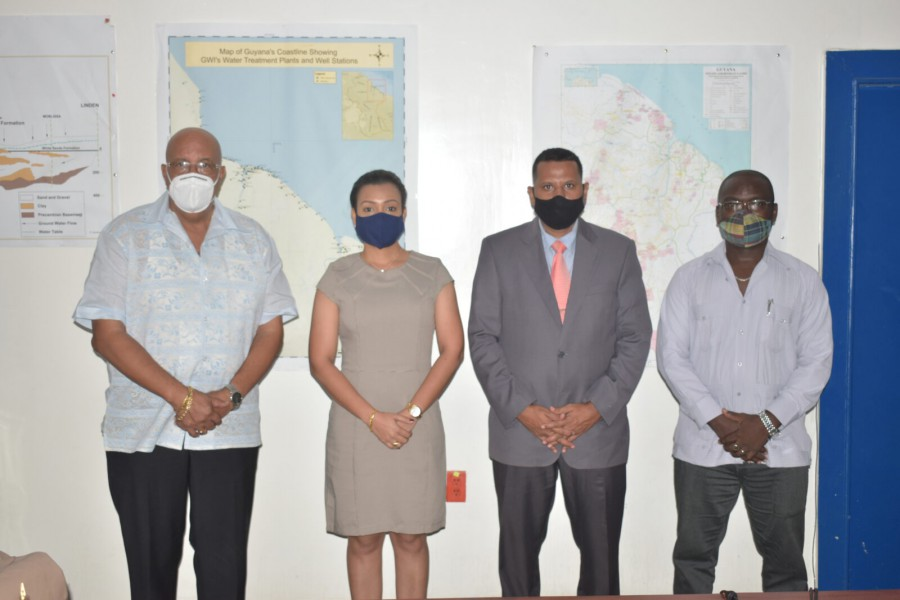 ( From left to right) Dr. Richard Van West-Charles, Managing Director of GWI, Minister Susan Rodrigues, Minister Collin Croal and Permanent Secretary of Housing and Water Emil McGarrell