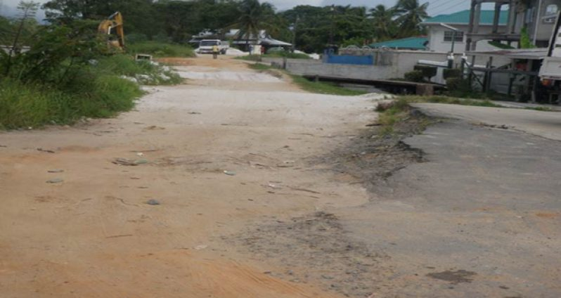 A section of the defective Charity river dam road